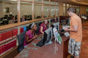 students asking for help at research center desk